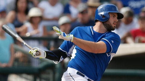 Mar 11, 2015; Surprise, AZ, USA; Kansas City Royals third baseman Mike Moustakas (8) hits a single in the fourth inning against the San Diego Padres during a spring training game at Surprise Stadium. Mandatory Credit: Rick Scuteri-USA TODAY Sports