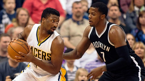 Mar 21, 2015; Indianapolis, IN, USA; Indiana Pacers forward Solomon Hill (44) looks to dribble as Brooklyn Nets forward Joe Johnson (7) defends in the second quarter of the game at Bankers Life Fieldhouse. Mandatory Credit: Trevor Ruszkowski-USA TODAY Sports