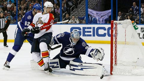 Mar 24, 2015; Tampa, FL, USA; Tampa Bay Lightning goalie Andrei Vasilevskiy (88) makes a save against the Florida Panthers during the third period at Amalie Arena. Tampa Bay Lightning defeated the Florida Panthers 4-3. Mandatory Credit: Kim Klement-USA TODAY Sports