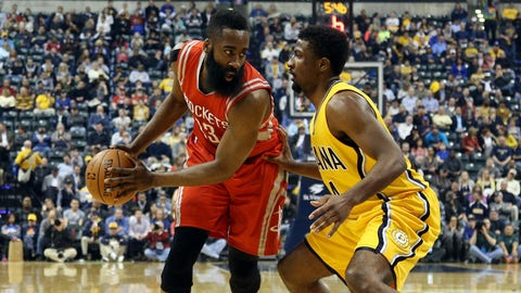 Mar 23, 2015; Indianapolis, IN, USA; Houston Rockets guard James Harden (13) is guarded by Indiana Pacers forward Solomon Hill (44) at Bankers Life Fieldhouse. Mandatory Credit: Brian Spurlock-USA TODAY Sports