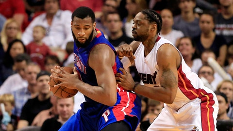 Mar 29, 2015; Miami, FL, USA;  Detroit Pistons center Andre Drummond (0) holds the ball as Miami Heat forward Henry Walker (5) defends in the second half at American Airlines Arena. The Heat won 109-102.  Mandatory Credit: Robert Mayer-USA TODAY Sports