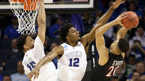 CHARLOTTE, NC - MARCH 22:  J.J. O'Brien #20 of the San Diego State Aztecs drives to the basket against teammates Jahlil Okafor #15 and Justise Winslow #12 of the Duke Blue Devils during the third round of the 2015 NCAA Men's Basketball Tournament at Time Warner Cable Arena on March 22, 2015 in Charlotte, North Carolina.  (Photo by Bob Leverone/Getty Images)