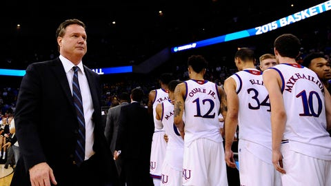 Mar 22, 2015; Omaha, NE, USA; Kansas Jayhawks head coach Bill Self (left) walks off the court after losing to the Wichita State Shockers in the third round of the 2015 NCAA Tournament at CenturyLink Center. Mandatory Credit: Jasen Vinlove-USA TODAY Sports