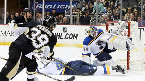Mar 24, 2015; Pittsburgh, PA, USA; St. Louis Blues goalie Jake Allen (34) makes a save against Pittsburgh Penguins left wing David Perron (39) during the second period at the CONSOL Energy Center. Mandatory Credit: Charles LeClaire-USA TODAY Sports