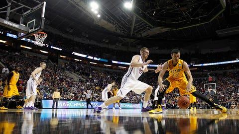 March 20, 2015; Seattle, WA, USA; Wyoming Cowboys forward Larry Nance Jr. (22) controls the ball against  Northern Iowa Panthers forward Seth Tuttle (10) during the second half of the second round of the 2015 NCAA Tournament at KeyArena. Mandatory Credit: Joe Nicholson-USA TODAY Sports