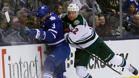 Mar 23, 2015; Toronto, Ontario, CAN; Minnesota Wild forward Nino Niederreiter (22) hits Toronto Maple Leafs defenceman Dion Phaneuf (3) along the boards during the second period at the Air Canada Centre. Mandatory Credit: John E. Sokolowski-USA TODAY Sports