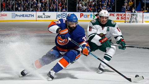 UNIONDALE, NY - MARCH 24: Brian Strait #37 of the New York Islanders moves the puck as he is checked by Zach Parise #11 of the Minnesota Wild during the first period at the Nassau Veterans Memorial Coliseum on March 24, 2015 in Uniondale, New York.  (Photo by Bruce Bennett/Getty Images)