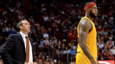 Dec 25, 2014; Miami, FL, USA; Cleveland Cavaliers head coach David Blatt (left) looks over at Cleveland Cavaliers forward LeBron James (right) during the first half against Miami Heat at American Airlines Arena. Mandatory Credit: Steve Mitchell-USA TODAY Sports