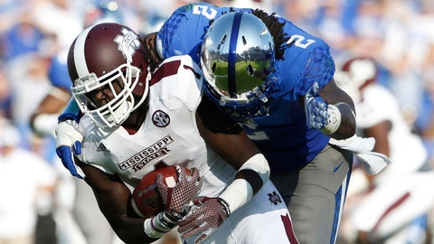 Oct 25, 2014; Lexington, KY, USA; Kentucky Wildcats defensive end Alvin Dupree (2) and cornerback Cody Quinn (16) tackle Mississippi State Bulldogs wide receiver De'Runnya Wilson (1) at Commonwealth Stadium. Mandatory Credit: Mark Zerof-USA TODAY Sports