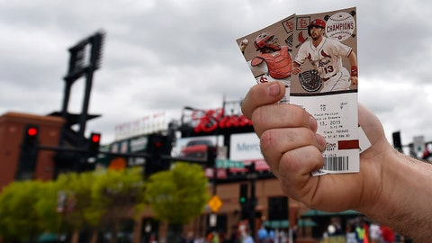 Apr 13, 2015; St. Louis, MO, USA; A fan sells tickets outside Busch Stadium before the game between the St. Louis Cardinals and the Milwaukee Brewers at Busch Stadium. Mandatory Credit: Jasen Vinlove-USA TODAY Sports