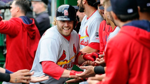 Apr 23, 2015; Washington, DC, USA; St. Louis Cardinals pinch hitter Mark Reynolds (12) is congratulated by teammates after scoring a run against the Washington Nationals during the eighth inning at Nationals Park. The St. Louis Cardinals won 4-1. Mandatory Credit: Brad Mills-USA TODAY Sports
