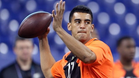 Feb 21, 2015; Indianapolis, IN, USA; Oregon Ducks quarterback Marcus Mariota throws a pass during the 2015 NFL Combine at Lucas Oil Stadium. Mandatory Credit: Brian Spurlock-USA TODAY Sports