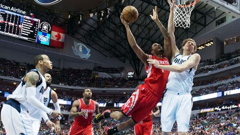 Apr 2, 2015; Dallas, TX, USA; Houston Rockets forward Trevor Ariza (1) drives to the basket as Dallas Mavericks forward Dirk Nowitzki (41) defends during the second half at the American Airlines Center. The Rockets defeated the Mavericks 108-101. Mandatory Credit: Jerome Miron-USA TODAY Sports