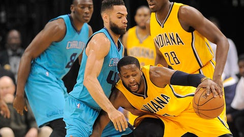 Apr 3, 2015; Indianapolis, IN, USA; Indiana Pacers guard C.J. Miles (0) loses control of the ball against Charlotte Hornets guard Jeff Taylor (44) during the game at Bankers Life Fieldhouse. Mandatory Credit: Thomas J. Russo-USA TODAY Sports