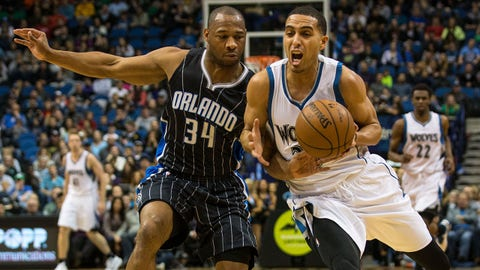 Apr 3, 2015; Minneapolis, MN, USA; Minnesota Timberwolves guard Kevin Martin (23) is fouled by Orlando Magic guard Willie Green (34) during the fourth quarter at Target Center. The Magic defeated Timberwolves 97-84. Mandatory Credit: Brace Hemmelgarn-USA TODAY Sports