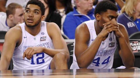 Apr 4, 2015; Indianapolis, IN, USA; Kentucky Wildcats forward Karl-Anthony Towns (12) and Dakari Johnson (44) sit on the bench following their loss to the Wisconsin Badgers 71-64 in the 2015 NCAA Men's Division I Championship semi-final game at Lucas Oil Stadium. Mandatory Credit: Robert Deutsch-USA TODAY Sports