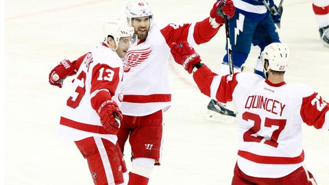 Apr 16, 2015; Tampa, FL, USA; Detroit Red Wings center Pavel Datsyuk (13) celebrates with left wing Henrik Zetterberg (40) and defenseman Kyle Quincey (27) after he scored a goal against the Tampa Bay Lightning during the first period in game one of the first round of the the 2015 Stanley Cup Playoffs at Amalie Arena. Mandatory Credit: Kim Klement-USA TODAY Sports