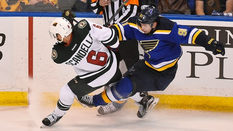 Apr 16, 2015; St. Louis, MO, USA; Minnesota Wild defenseman Marco Scandella (6) checks St. Louis Blues right wing Vladimir Tarasenko (91) in the third period in game one of the first round of the the 2015 Stanley Cup Playoffs at Scottrade Center. The Minnesota Wild defeat the St. Louis Blues 4-2. Mandatory Credit: Jasen Vinlove-USA TODAY Sports