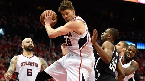 Apr 29, 2015; Atlanta, GA, USA; Atlanta Hawks guard Kyle Korver (26) grabs a rebound in front of Brooklyn Nets forward Thaddeus Young (30) during the first half in game five of the first round of the NBA Playoffs. at Philips Arena. Mandatory Credit: Dale Zanine-USA TODAY Sports