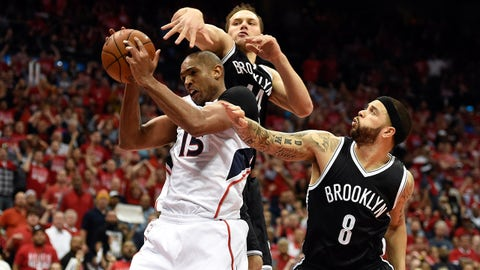 Apr 29, 2015; Atlanta, GA, USA; Atlanta Hawks center Al Horford (15) is defended by Brooklyn Nets guard Bojan Bogdanovic (44) and guard Deron Williams (8) during the second half in game five of the first round of the NBA Playoffs at Philips Arena. The Hawks defeated the Nets 107-97. Mandatory Credit: Dale Zanine-USA TODAY Sports