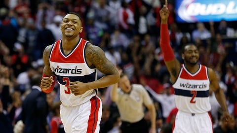 Apr 26, 2015; Washington, DC, USA; Washington Wizards guard Bradley Beal (3) smiles after making a three point field goal as Wizards guard John Wall (2) celebrates against the Toronto Raptors in the fourth quarter in game four of the first round of the NBA Playoffs at Verizon Center. The Wizards won 125-94, and won the series 4-0. Mandatory Credit: Geoff Burke-USA TODAY Sports