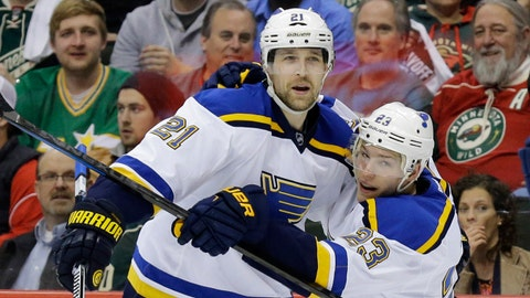 St. Louis Blues center Patrik Berglund (21), of Sweden, right wing Dmitrij Jaskin (23), of Russia, and center Paul Stastny (26) celebrate Berglund's goal on Minnesota Wild goalie Devan Dubnyk during the second period of Game 4 of an NHL hockey first-round playoff series game in St. Paul, Minn., Wednesday, April 22, 2015. (AP Photo/Ann Heisenfelt)