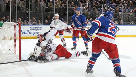 NEW YORK, NY - APRIL 06:  Derek Stepan #21 of the New York Rangers shoots and scores late in the third period to tie the game against Sergei Bobrovsky #72 and David Savard #58 of the Columbus Blue Jackets at Madison Square Garden on April 6, 2015 in New York City. (Photo by Jared Silber/NHLI via Getty Images)