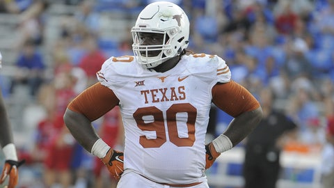 Sep 27, 2014; Lawrence, KS, USA; Texas Longhorns defensive tackle Malcom Brown (90) between plays against the Kansas Jayhawks in the second half at Memorial Stadium. Texas won the game 23-0. Mandatory Credit: John Rieger-USA TODAY Sports