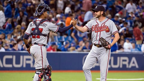 Apr 19, 2015; Toronto, Ontario, CAN; Atlanta Braves relief pitcher Jason Grilli (39) celebrates the win with catcher Christian Bethancourt (27) at the end of a game against the Toronto Blue Jays at Rogers Centre. The Atlanta Braves won 5-2. Mandatory Credit: Nick Turchiaro-USA TODAY Sports