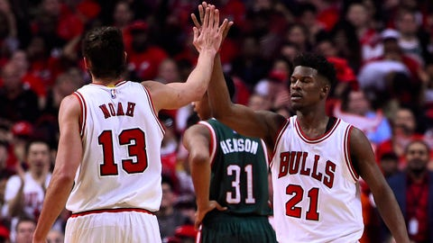 Apr 20, 2015; Chicago, IL, USA; Chicago Bulls guard Jimmy Butler (21) reacts with center Joakim Noah (13) after making a shot against the Milwaukee Bucks during the second quarter in game two of the first round of the 2015 NBA Playoffs at the United Center. Mandatory Credit: Mike DiNovo-USA TODAY Sports