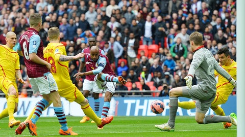 Aston Villa's English midfielder Fabian Delph (C) shoots and scores past Liverpool's Belgian goalkeeper Simon Mignolet (R) during the FA Cup semi-final between Aston Villa and Liverpool at Wembley stadium in London on April 19, 2015.