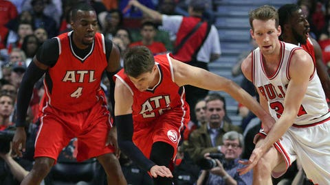 Apr 15, 2015; Chicago, IL, USA; Atlanta Hawks guard Kyle Korver (26) and Chicago Bulls forward Mike Dunleavy (34) play for the ball during the first quarter at the United Center. Mandatory Credit: Dennis Wierzbicki-USA TODAY Sports