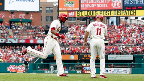 Apr 18, 2015; St. Louis, MO, USA; St. Louis Cardinals right fielder Jason Heyward (22) is congratulated by third base coach Jose Oquendo (11) after hitting a home run off of Cincinnati Reds starting pitcher Homer Bailey (not pictured) during the third inning at Busch Stadium. Mandatory Credit: Billy Hurst-USA TODAY Sports