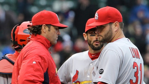 St. Louis Cardinals manager Mike Matheny, left, takes the ball from starting pitcher Lance Lynn during the seventh inning of a baseball game against the Chicago Cubs in Chicago, Wednesday, April  8, 2015. (AP Photo/Nam Y. Huh)