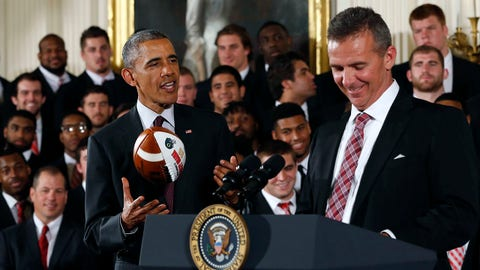 Apr 20, 2015; Washington, DC, USA; Ohio State Buckeyes head coach Urban Meyer (right) laughs as President Barack Obama (left) tosses a gift game ball during a ceremony honoring the 2014 NCAA football national champions in the East Room at the White House. Mandatory Credit: Geoff Burke-USA TODAY Sports