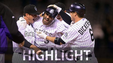 Apr 22, 2015; Denver, CO, USA; Colorado Rockies pinch hitter Daniel Descalso (3) celebrates with teammates including left fielder Corey Dickerson (6) and center fielder Drew Stubbs (right) after hitting a walk off single during the ninth inning against the San Diego Padres at Coors Field. The Rockies won 5-4.  Mandatory Credit: Chris Humphreys-USA TODAY Sports