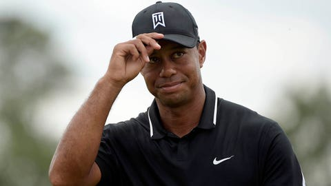 Apr 10, 2015; Augusta, GA, USA; Tiger Woods tips his cap to the crowd after completing the second round of The Masters golf tournament at Augusta National Golf Club. Mandatory Credit: Michael Madrid-USA TODAY Sports