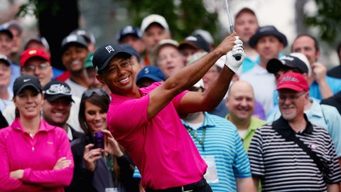 AUGUSTA, GA - APRIL 07:  Tiger Woods of the United States smiles in front of a group of patrons on a tee box during a practice round prior to the start of the 2015 Masters Tournament at Augusta National Golf Club on April 7, 2015 in Augusta, Georgia.  (Photo by Andrew Redington/Getty Images)