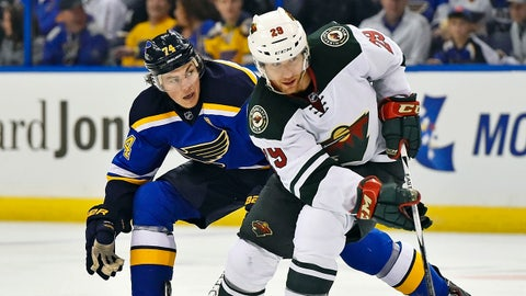 Apr 18, 2015; St. Louis, MO, USA; St. Louis Blues right wing T.J. Oshie (74) pressures Minnesota Wild right wing Jason Pominville (29) during the second period in game two of the first round of the the 2015 Stanley Cup Playoffs at Scottrade Center. Mandatory Credit: Jasen Vinlove-USA TODAY Sports