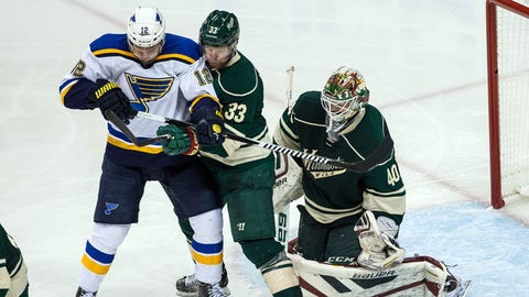 Apr 20, 2015; Saint Paul, MN, USA; Minnesota Wild goalie Devan Dubnyk (40) makes a save in front of defenseman Jordan Leopold (33) and St. Louis Blues forward Jori Lehtera (12) during the third period in game three of the first round of the 2015 Stanley Cup Playoffs at Xcel Energy Center. The Wild defeated the Blues 3-0. Mandatory Credit: Brace Hemmelgarn-USA TODAY Sports