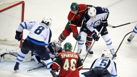Apr 6, 2015; Saint Paul, MN, USA;  Winnipeg Jets defenseman Jacob Trouba (8) and Minnesota Wild forward Charlie Coyle (3) and Winnipeg Jets forward Mark Scheifele (55) scramble for a loose puck during the third period at Xcel Energy Center.  The Jets defeated the Wild 2-0.  Mandatory Credit: Marilyn Indahl-USA TODAY Sports