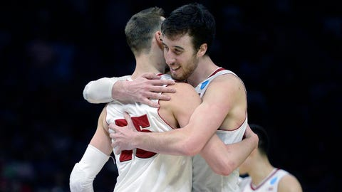 Mar 28, 2015; Los Angeles, CA, USA; Wisconsin Badgers forward Sam Dekker (15) and forward Frank Kaminsky (44) celebrate during the 85-78 victory against Arizona Wildcats during the second half in the finals of the west regional of the 2015 NCAA Tournament at Staples Center. Mandatory Credit: Robert Hanashiro-USA TODAY Sports