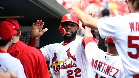 May 7, 2015; St. Louis, MO, USA; St. Louis Cardinals right fielder Jason Heyward (22) celebrates on the dugout with teammates after scoring a run against the Chicago Cubs at Busch Stadium. Mandatory Credit: Jasen Vinlove-USA TODAY Sports