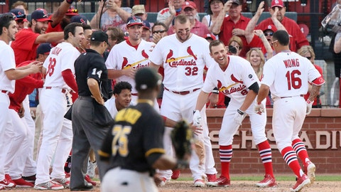 St. Louis Cardinals' Kolten Wong (16) is congratulated by teammates at home plate after hitting a walk-off home run in the 14th inning during a baseball game between the Cardinals and the Pirates on Sunday, May 3, 2015, at Busch Stadium in St. Louis.    (Chris Lee/St. Louis Post-Dispatch via AP)  EDWARDSVILLE INTELLIGENCER OUT; THE ALTON TELEGRAPH OUT; MANDATORY CREDIT