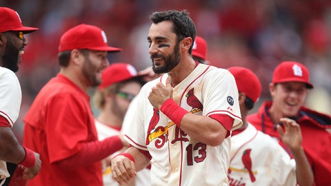 St. Louis Cardinals Matt Carpenter celebrates his game winning sacrifice fly ball to defeat the Pittsburgh Pirates, with teammates in the 11th inning  at Busch Stadium in St. Louis on May 2, 2015. St. Louis won the game 2-1.   Photo by Bill Greenblatt/UPI