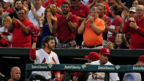 May 4, 2015; St. Louis, MO, USA; St. Louis Cardinals first baseman Mark Reynolds (12) is given a curtain call after hitting a grand slam off of Chicago Cubs starting pitcher Travis Wood (not pictured) during the first inning at Busch Stadium. Mandatory Credit: Jeff Curry-USA TODAY Sports