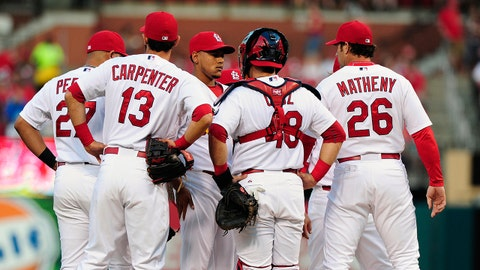 May 4, 2015; St. Louis, MO, USA; St. Louis Cardinals starting pitcher Carlos Martinez (18) talks with manager Mike Matheny (26) during the first inning against the Chicago Cubs at Busch Stadium. Mandatory Credit: Jeff Curry-USA TODAY Sports