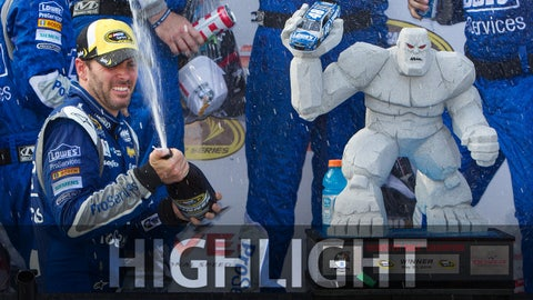 May 31, 2015; Dover, DE, USA; NASCAR Sprint Cup Series driver Jimmie Johnson (48) sprays champagne in victory lane after winning the FedEx 400 benefiting Autism Speaks at Dover International Speedway. Mandatory Credit: Matthew O'Haren-USA TODAY Sports
