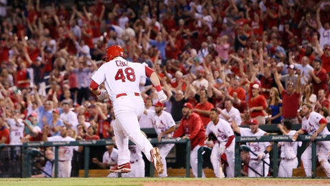 St. Louis Cardinals' Tony Cruz gives his team their first lead of the game with a two-run double in the seventh inning during a baseball game against the Chicago Cubs, Monday, May 4, 2015, in St. Louis. (Chris Lee/St. Louis Post-Dispatch via AP)