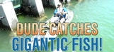 Dude catches gigantic fish!
